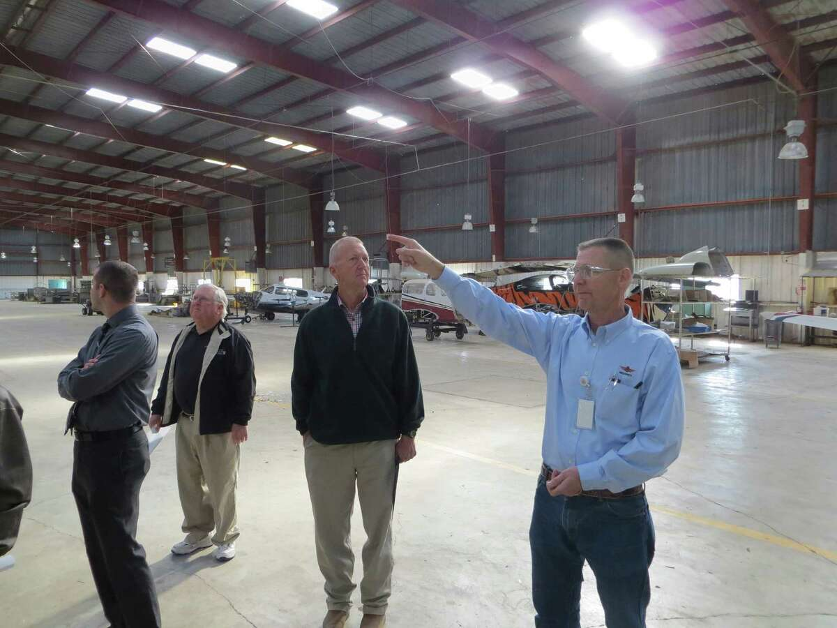 Chad Nelson, chief manufacturing officer at Mooney International Corp., discusses needed roof repairs with Kerr County officials on Monday 3/7 at the airplane factory where production work resumed in February for the first time since 2008