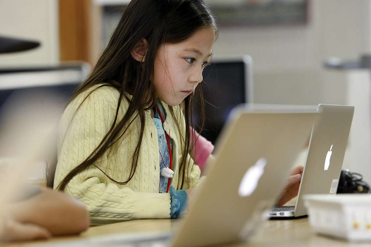 First grader Caitlin Chin works on a lesson during an after school computer science class called Codekids that teaches simple coding to students at Old Mill School in Mill Valley, CA, Tuesday, March 18, 2014.