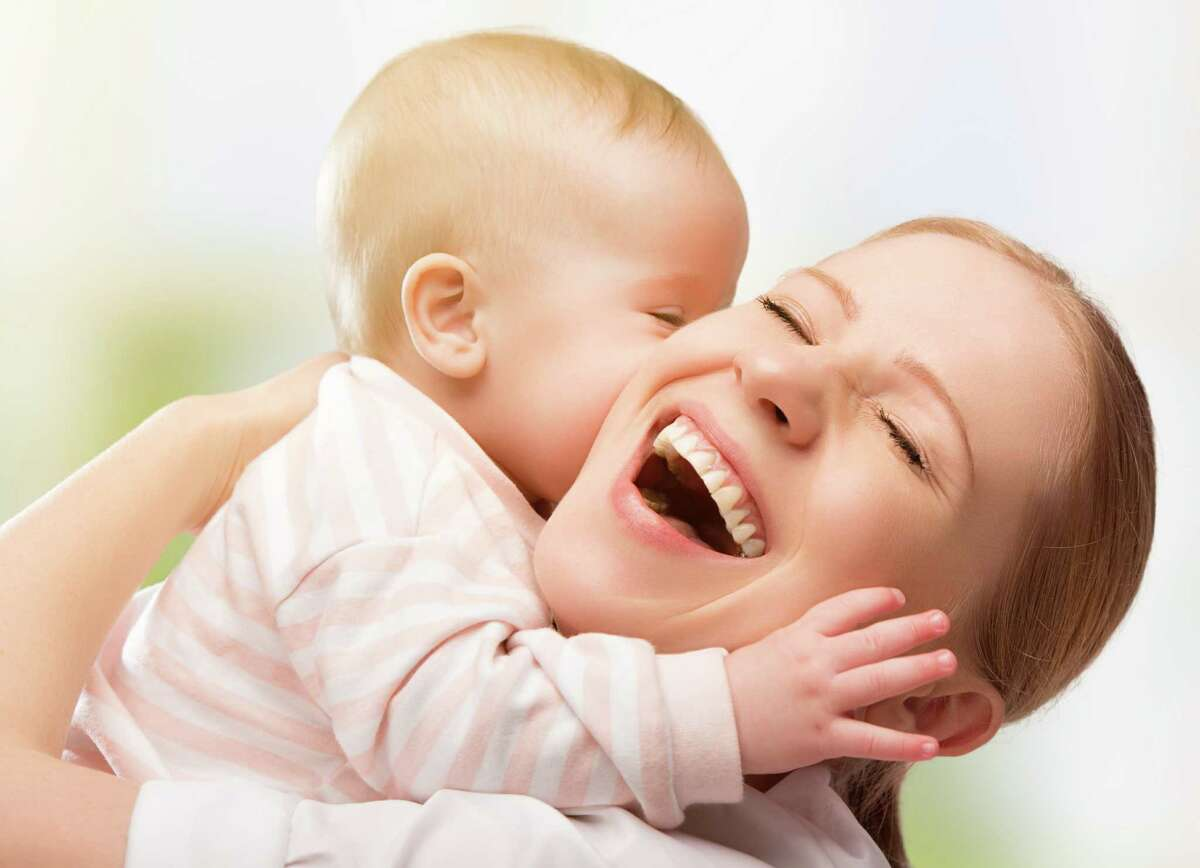 Having a baby can change work plans for both women and men. (Fotolia.com)