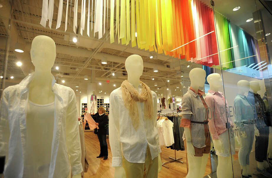 Mannequins dressed in linen shirts face out through floor to ceiling glass walls in the Uniqlo store at the Westfield Trumbull Mall on Monday, April 6, 2014. Photo: Brian A. Pounds / Connecticut Post