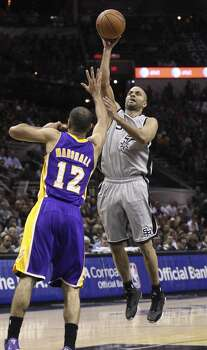 Spurs' Tony Parker (09) puts up a shot against Los Angeles Lakers' Kendall Marshall (12) in the first half at the AT&T Center on Friday, March 14, 2014. Photo: Kin Man Hui, San Antonio Express-News