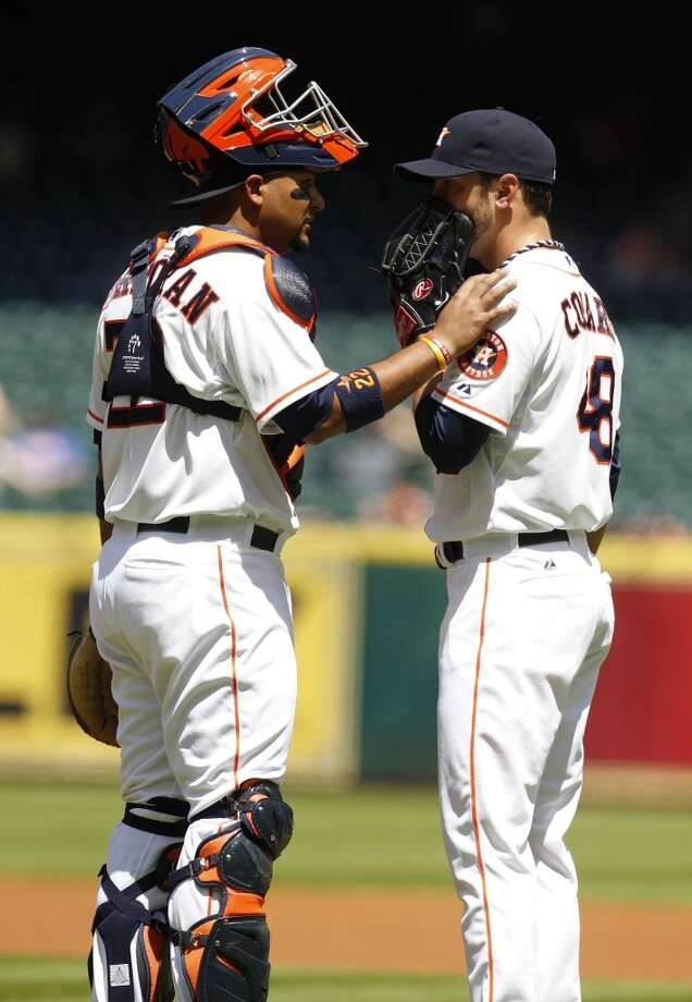 Astros starting pitcher Jarred Cosart chats with catcher Carlos Corporan during the first inning. Photo: Karen Warren, Houston Chronicle