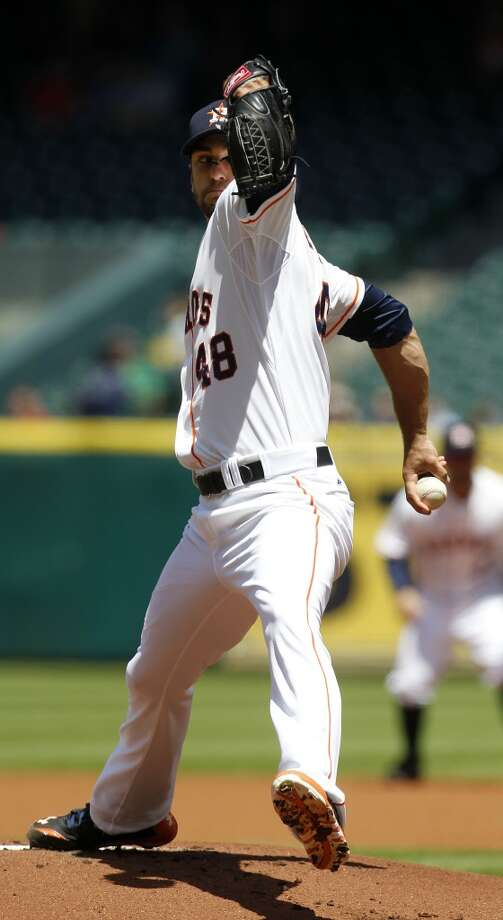 Astros starting pitcher Jarred Cosart pitches during the first inning. Photo: Karen Warren, Houston Chronicle