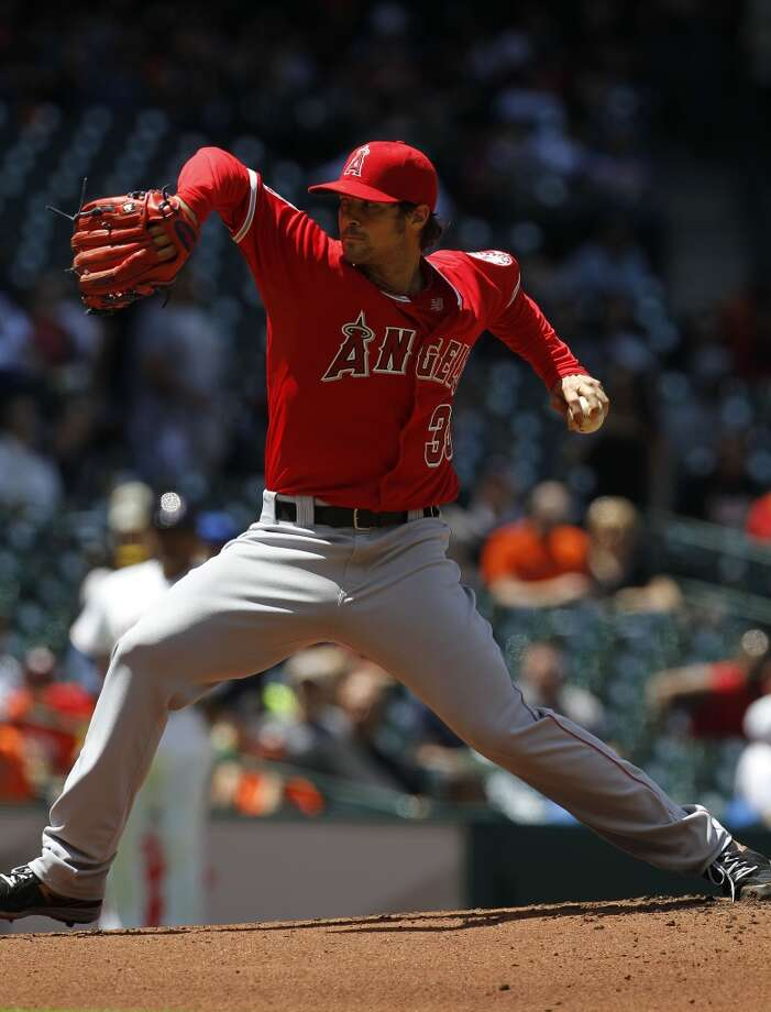 Los Angeles Angels starting pitcher C.J. Wilson pitches during the first inning. Photo: Karen Warren, Houston Chronicle