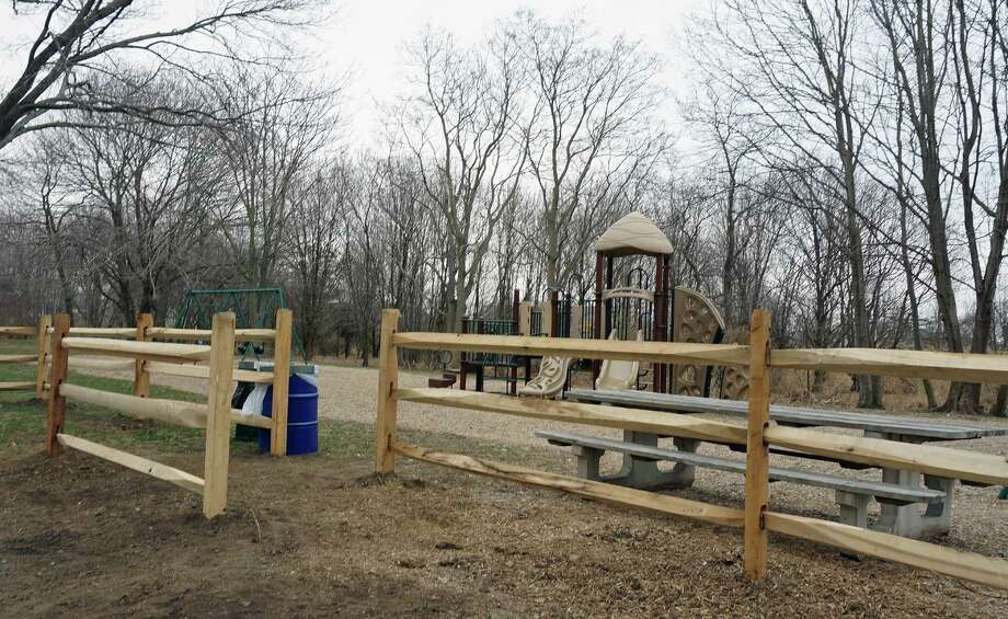 New protective fencing has been installed in front of the Veterans Park playground where Edward Street passes through the area. Photo: Genevieve Reilly / Fairfield Citizen