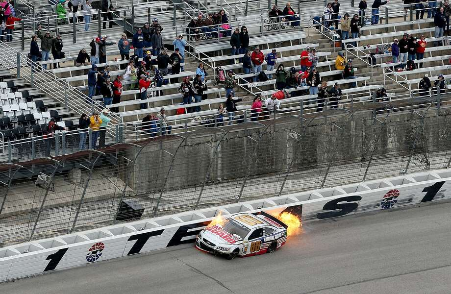 Dale Earnhardt Jr., driver of the #88 National Guard Chevrolet, crashes early in the NASCAR Sprint Cup Series Duck Commander 500 at Texas Motor Speedway on April 7, 2014 in Fort Worth, Texas. Photo: Nick Laham, (Credit Too Long, See Caption)