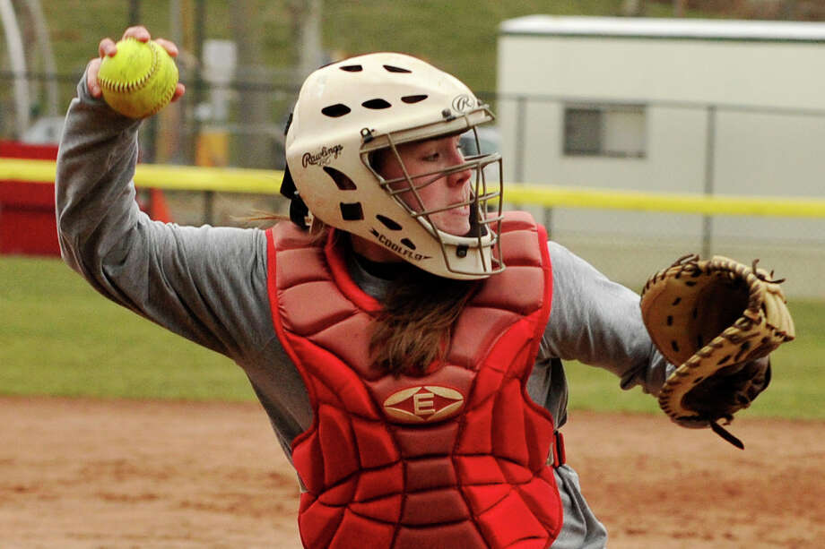 Erin Ferguson throws to first after fielding a bunted ball during softball practice at Greenwich High School in Greenwich, Conn., on Monday, April 7, 2014. Photo: Jason Rearick / Stamford Advocate