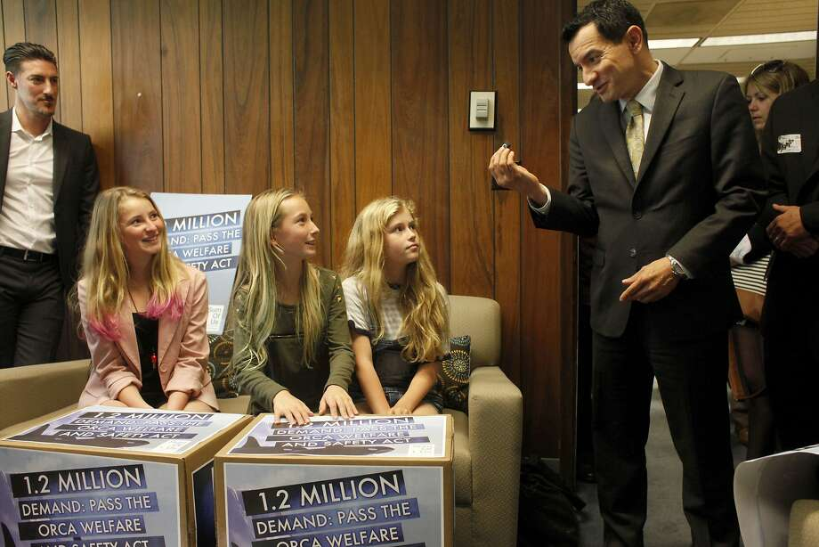 Ava (left) and Kirra Kotler and Lizzie Gordon bring a petition to Assemblyman Anthony Rendon in support of AB2140. Photo: Lacy Atkins, SFC
