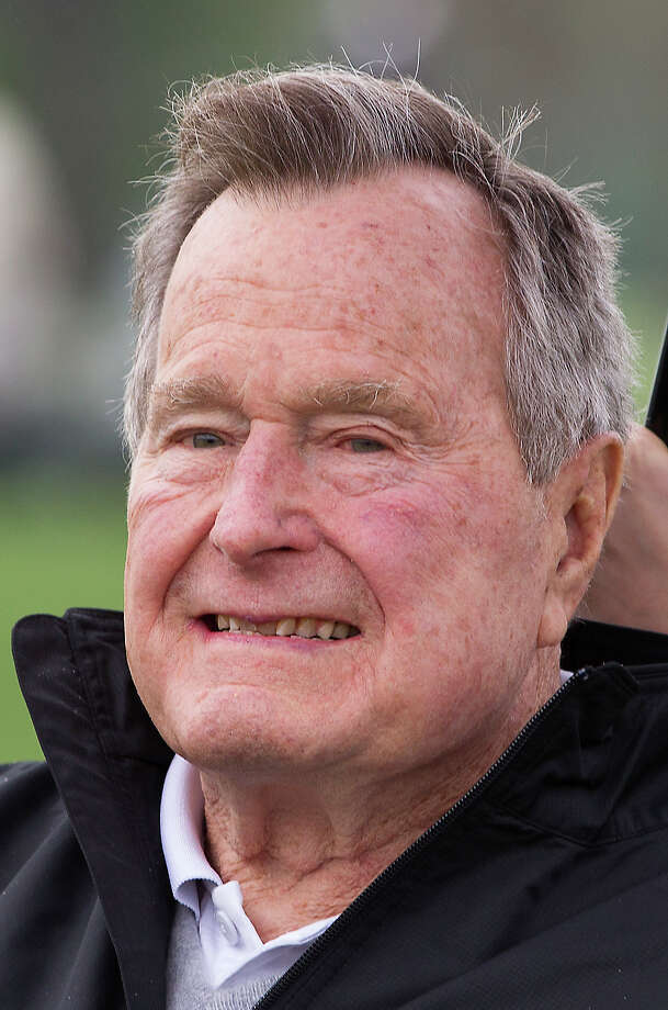 Former President George H. W. Bush attends the final round of the Houston Open golf tournament, Sunday, April 6, 2014, in Humble, Texas. (AP Photo/Patric Schneider) Photo: Patric Schneider, Associated Press / FR170473 AP