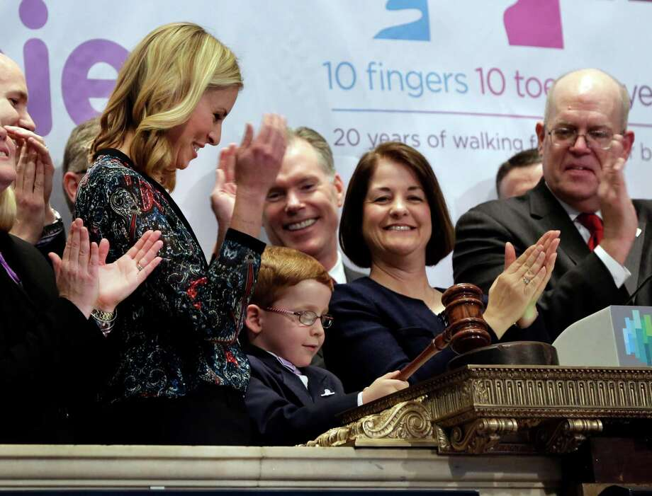 Supermodel Niki Taylor, left, watches as March of Dimes 2014 National Ambassador Aidan Lamothe gavels trading of the New York Stock Exchange closed, Monday, April 7, 2014.  (AP Photo/Richard Drew) ORG XMIT: NYRD119 Photo: Richard Drew / AP