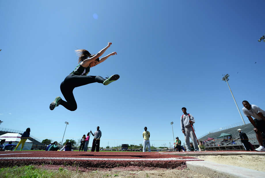A Little Cypress-Mauriceville athlete competes in the triple jump event Monday afternoon. The District 20-4A track meet was held at Babe Zaharias Park on Monday. Photo taken Monday, 4/7/14 Jake Daniels/@JakeD_in_SETX Photo: Jake Daniels / ©2014 The Beaumont Enterprise/Jake Daniels