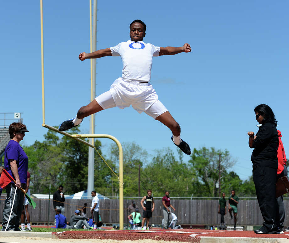 Ozen's Michael Banks competes in the long jump event of Monday's track meet. The District 20-4A track meet was held at Babe Zaharias Park on Monday.