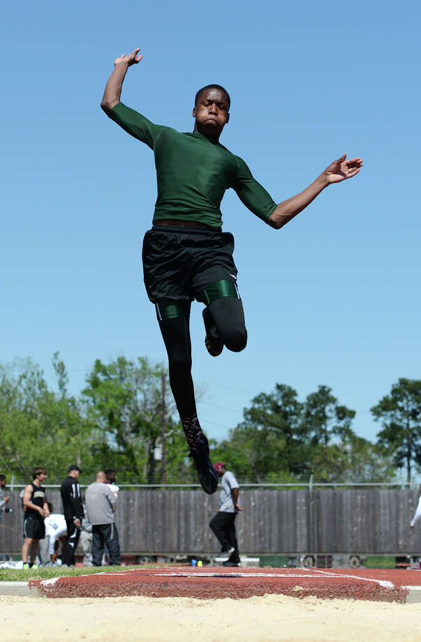Livingston's Tarien Miller competes in the long jump event during Monday's meet. The District 20-4A track meet was held at Babe Zaharias Park on Monday. Photo taken Monday, 4/7/14 Jake Daniels/@JakeD_in_SETX Photo: Jake Daniels / ©2014 The Beaumont Enterprise/Jake Daniels