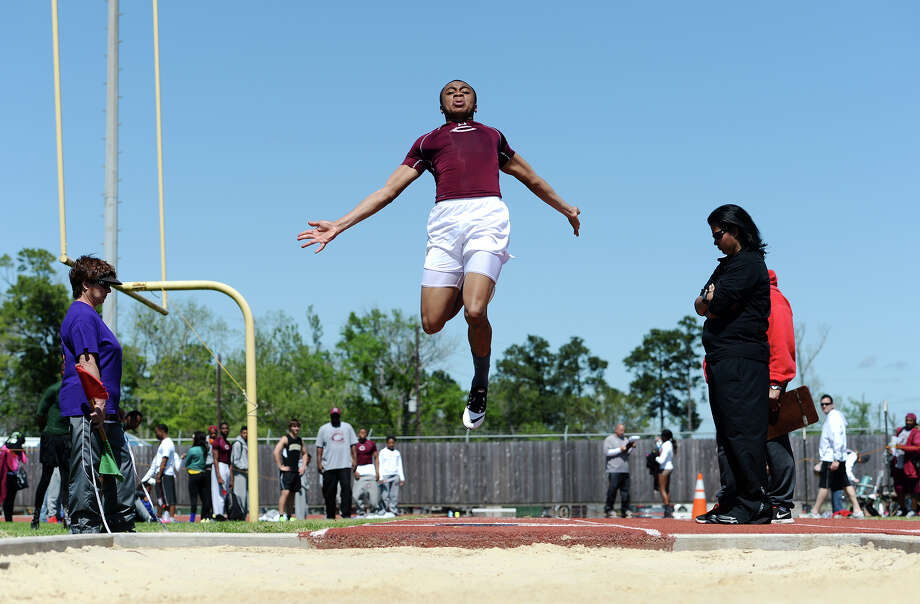 Central's Kamon Darby competes in the long jump event during Monday's meet. The District 20-4A track meet was held at Babe Zaharias Park on Monday.