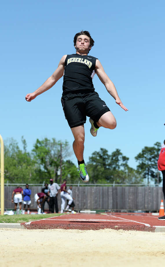 Nederland's Adam Richard competes in the long jump event of Monday's track meet. The District 20-4A track meet was held at Babe Zaharias Park on Monday.