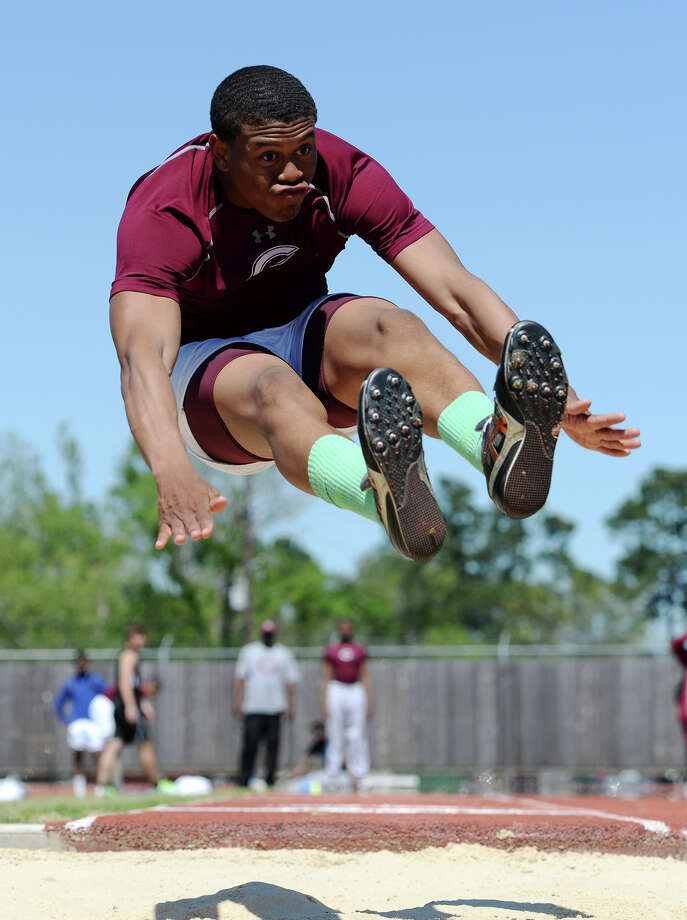 Central's Devwah Whaley preps for his landing while competing in the long jump event at Monday's meet. The District 20-4A track meet was held at Babe Zaharias Park on Monday.