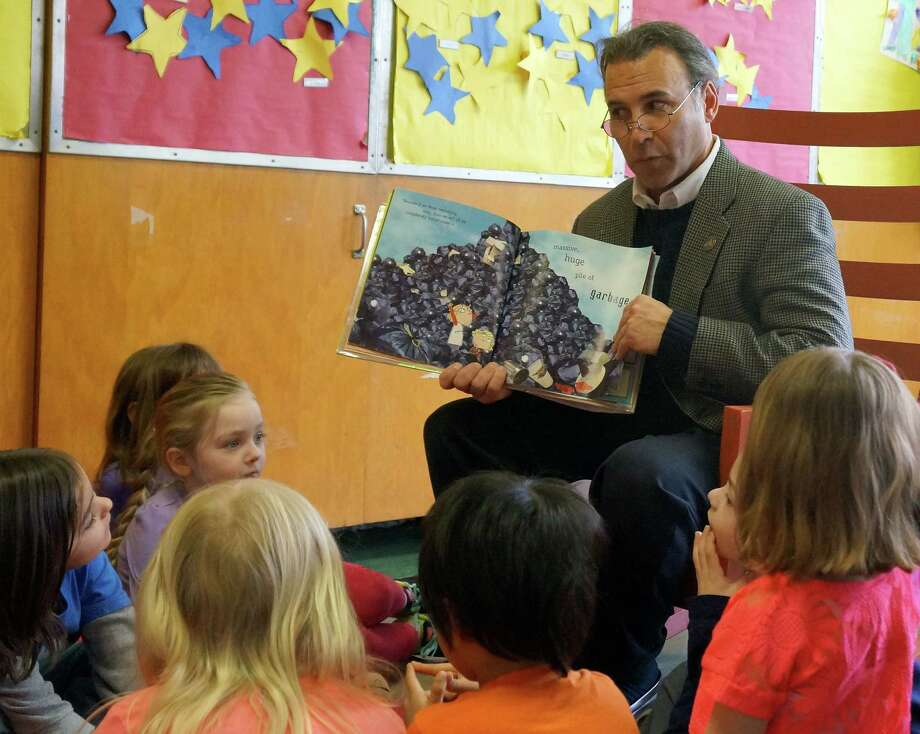 State Rep. Fred Camillo reads to kids Monday morning at theYMCA childcare center on St. Roch Avenue Photo: Paul Schott, Anne Semmes / Greenwich Time