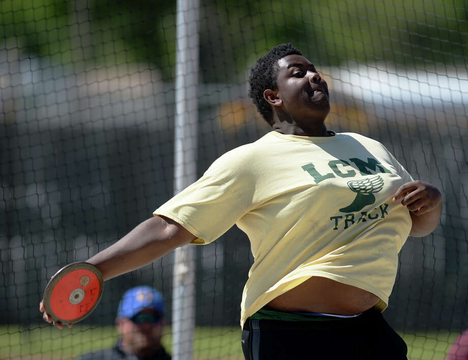 Little Cypress-Mauriceville's Marvis Brown throws a discus on Monday afternoon during the track meet. The District 20-4A track meet was held at Babe Zaharias Park on Monday.