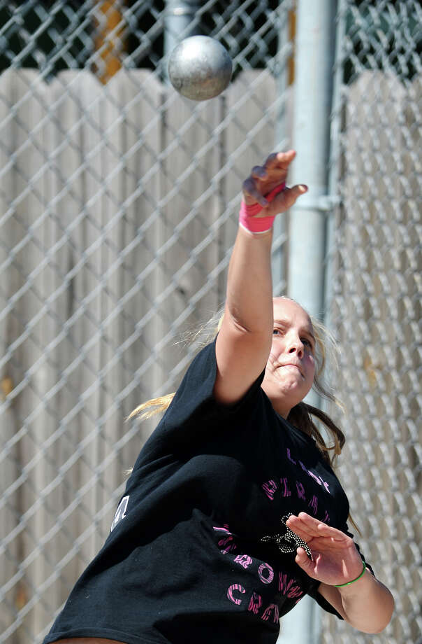 Vidor's Brooke Novak throws during the shot put event of Monday's meet. The District 20-4A track meet was held at Babe Zaharias Park on Monday.