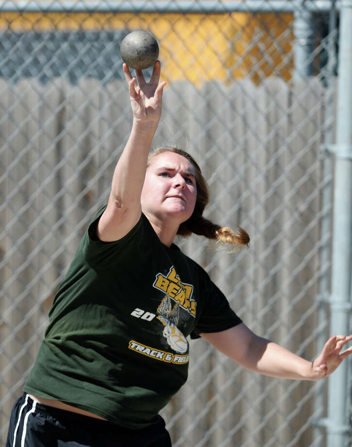 Little Cypress-Mauriceville's Emalee Carlton throws during the shot put event Monday afternoon. The District 20-4A track meet was held at Babe Zaharias Park on Monday.