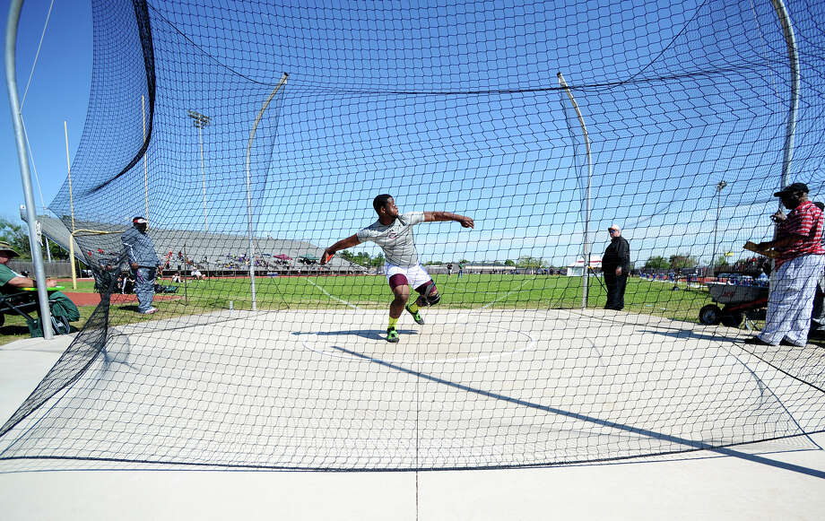 Central's Chris Allen warms up for the discus event during Monday's meet. The District 20-4A track meet was held at Babe Zaharias Park on Monday.