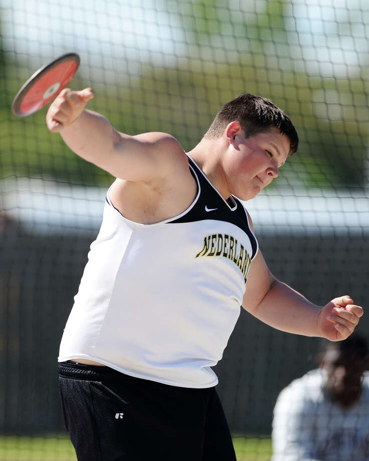 Nederland's Hunter Ellis competes in the discus event of Monday's meet. The District 20-4A track meet was held at Babe Zaharias Park on Monday.