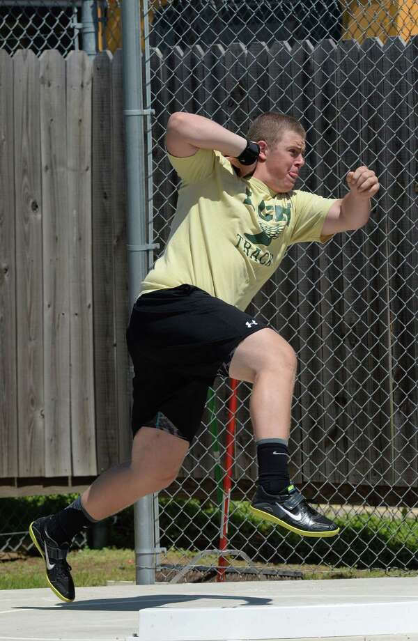 Little Cypress Mauriceville's Ethan Reed competes in the shot put during a track meet at the Jaguar's stadium on Monday. 