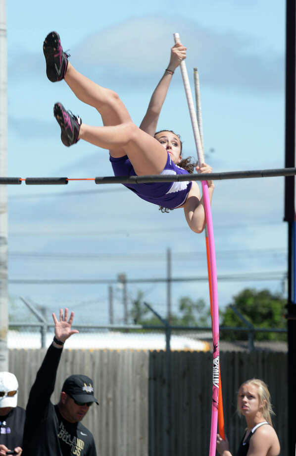 Port Neches-Groves' Jolie Spencer pole vaults during competition at the Jaguar's stadium on Monday. 