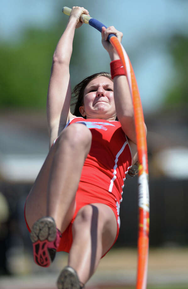 Lumberton's Mika Brinson pole vaults during competition at the Jaguar's stadium on Monday. 