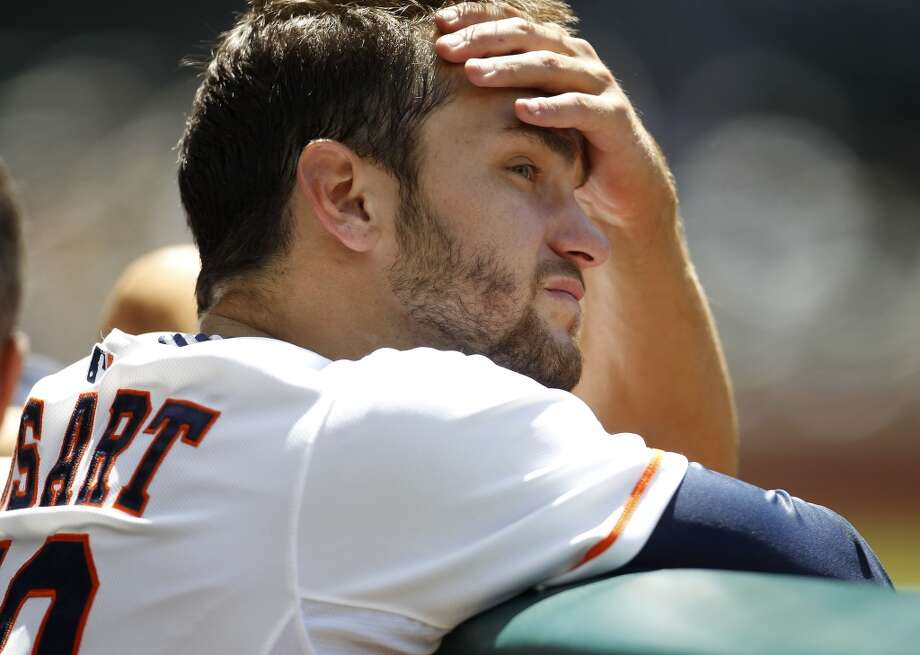 Astros starting pitcher Jarred Cosart stands at the top of the dugout as he watches the action during the sixth inning. Photo: Karen Warren, Houston Chronicle