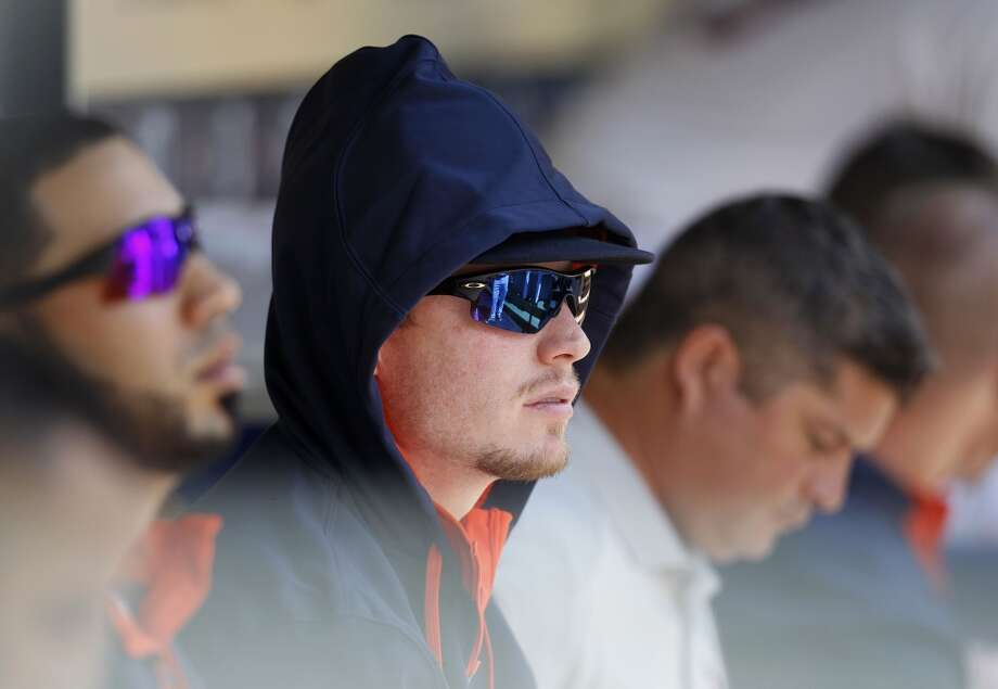 Astros starting pitcher Lucas Harrell wears a hoodie in the dugout during the fifth inning. Photo: Karen Warren, Houston Chronicle