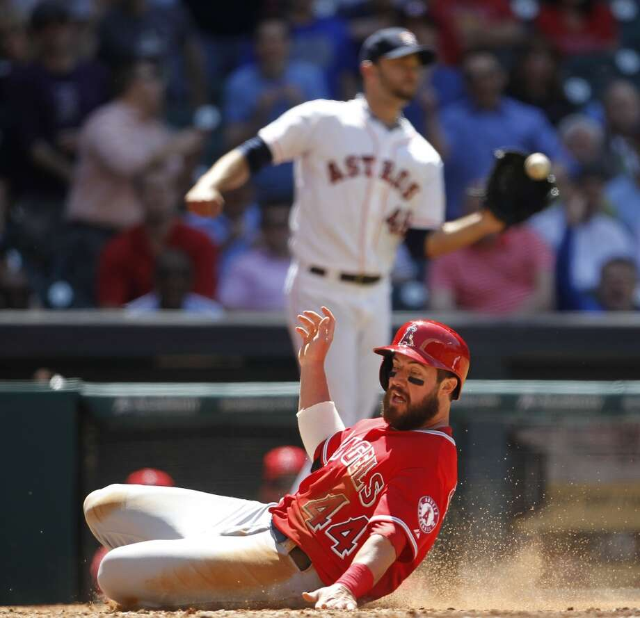 Angels third baseman Ian Stewart slides into home on a sacrifice fly by Angels catcher Chris Iannetta during the sixth inning. Photo: Karen Warren, Houston Chronicle