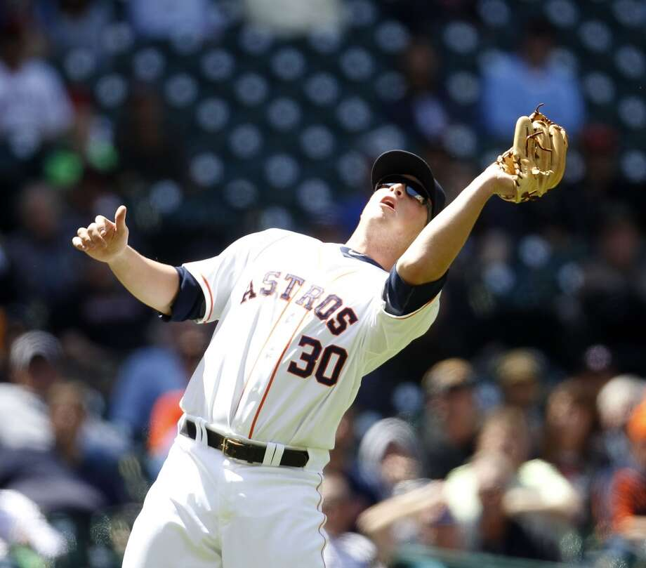 Astros third baseman Matt Dominguez catches a pop out on Angels first baseman Albert Pujols during the third inning. Photo: Karen Warren, Houston Chronicle