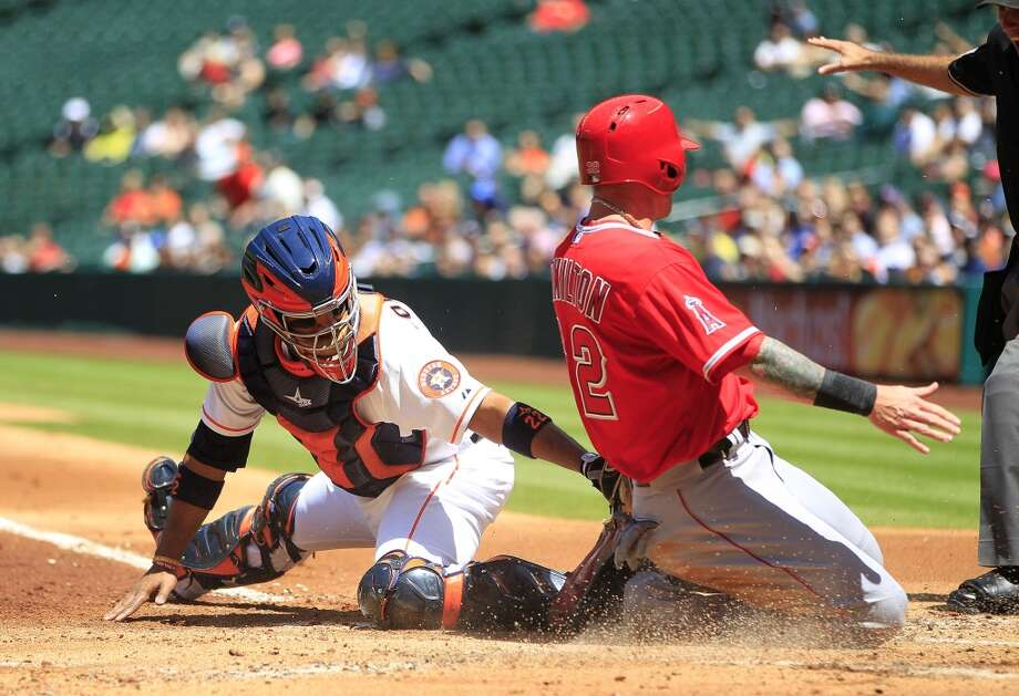 Angels left fielder Josh Hamilton is safe at home on a single by Angels second baseman Howie Kendrick during the first inning. Photo: Karen Warren, Houston Chronicle