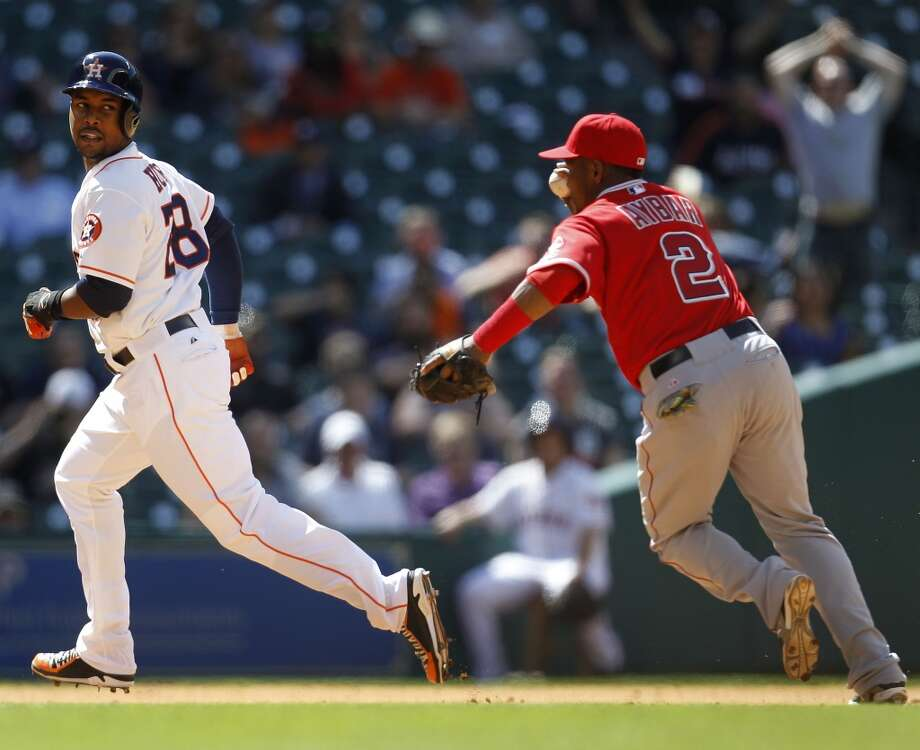 Angels shortstop Erick Aybar runs toward Astros right fielder L.J. Hoes on the run down between second and third base during the eighth inning. Photo: Karen Warren, Houston Chronicle