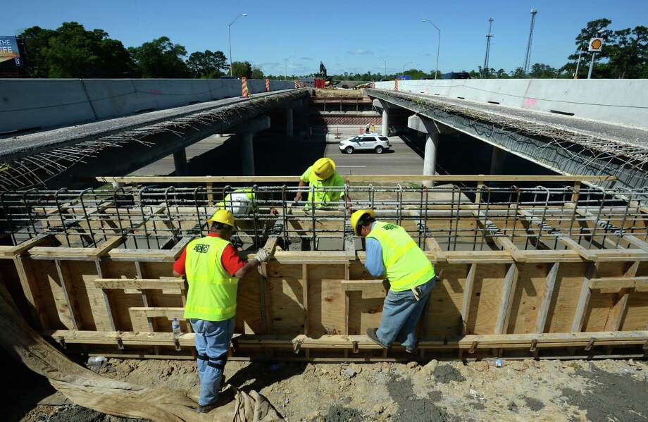 Construction workers prepare, Monday, the Delaware St. overpass of Texas 69 for modification. The space between the north and south bound lanes is expected to be filled in to provide more lanes of traffic.  Photo taken Monday, April 07, 2014 Guiseppe Barranco/@spotnewsshooter Photo: Guiseppe Barranco, Photo Editor