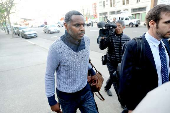 Keith Jackson, who faces federal charges in connection with an investigation into state Sen. Leland Yee, leaves jail in Oakland, Calif., on Thursday, April 3, 2014. Jackson, a former San Francisco school board president, is charged with gun running, drug trafficking and arranging a purported murder for hire.