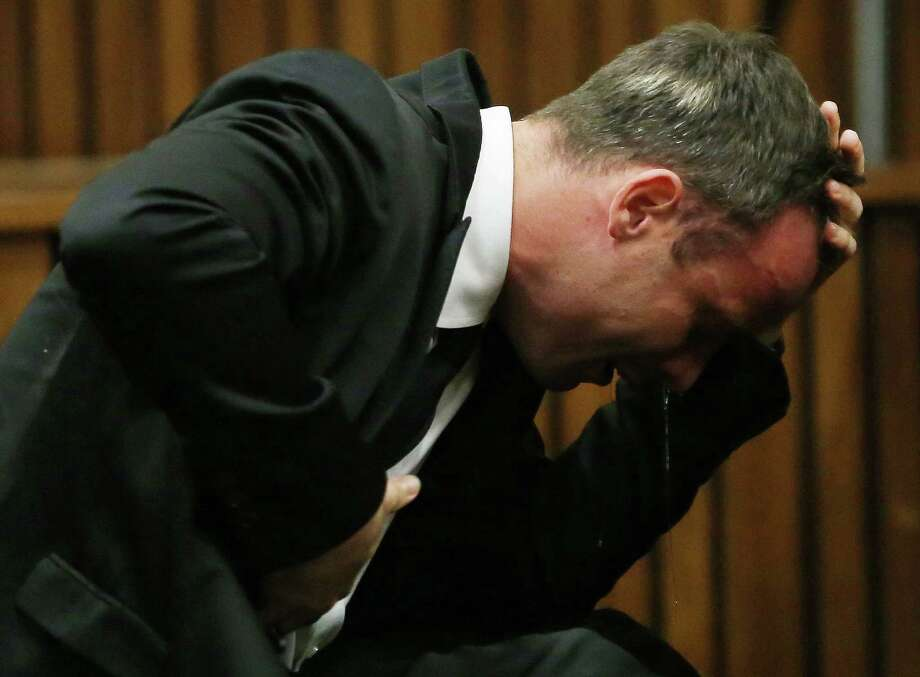 Oscar Pistorius weeps Monday as he listens to a pathologist testify in court in Pretoria, South Africa. Photo: Themba Hadebe, POOL / AP POOL