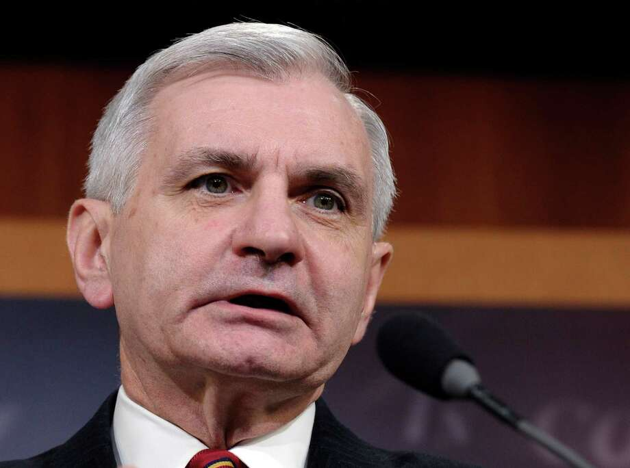 FILE - This Feb. 6, 2014 file photo shows Sen. Jack Reed, D-R.I. speaking during a news conference on unemployment insurance on Capitol Hill in Washington. Capping a three-month struggle, the Senate closed in Monday on passage of election-year legislation to restore jobless benefits for the long-term unemployed that expired late last year. Approval would send the legislation to a hostile reception in the House, where majority Republicans generally oppose it. Even before the Senate vote, Reed and Sen. Dean Heller, R-Nev., the bill's leading supporters, said they were willing to consider changes in hopes of securing passage in a highly reluctant House. (AP Photo/Susan Walsh, File) Photo: Susan Walsh, STF / AP