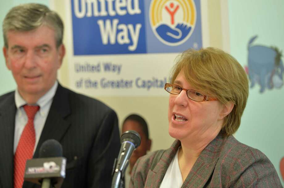 Abbe Kovacik, executive director,Capital Child Care Council at the podium announces an three year annual grant in conjunction with United Way of Greater Capital Region for $85,000 to allow early care providers in Rensselaer county to participate in QUALITYSarsNY at a press conference April 7, 2014 in Troy, N.Y.  Looking on is Senator Neil Breslin, left.   (Skip Dickstein / Times Union) Photo: SKIP DICKSTEIN / 00026395A