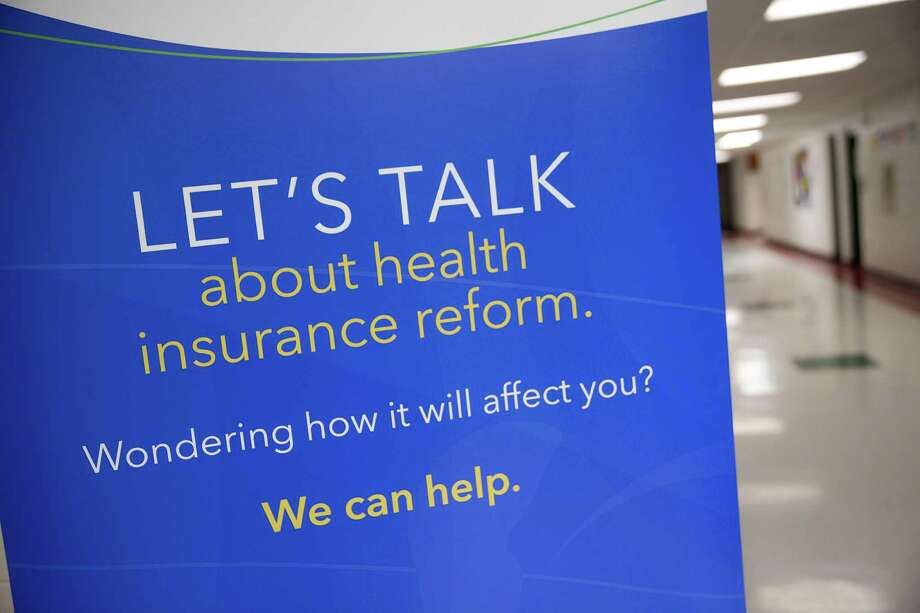 A Choose Health Delaware sign stands outside an Affordable Care Act enrollment event in Milford, Delaware, U.S., on Thursday, March 27, 2014. Six million Americans have signed up for private health plans under Obamacare, President Barack Obama said, a symbolic milestone for a government that has struggled to get the law off the ground. Photographer: Andrew Harrer/Bloomberg Photo: Andrew Harrer, Bloomberg / © 2014 Bloomberg Finance LP