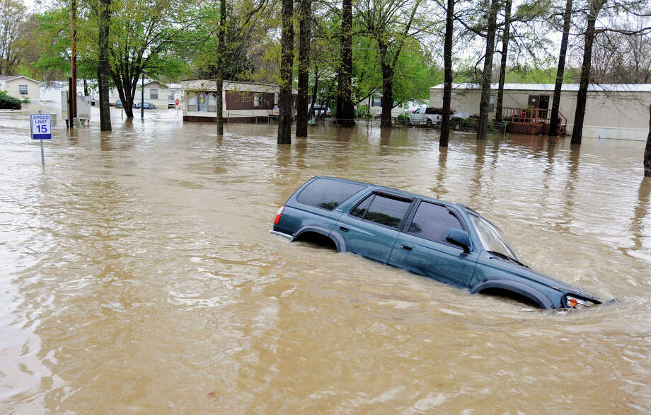 A vehicle is submerged by floodwaters in Pelham, Ala., on Monday after torrential rains hit the area. Photo: Jay Reeves, STF / AP