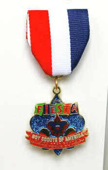 "The Boy Scout of America Alamo Area Council's Fiesta medal celebrates its ""Unified Focus on Youth,"" and sells for $10 at the Fiesta Store and the council's office at 2226 N.W. Military Hwy., www.AlamoAreaBSA.org. Photo: Courtesy Photo, Boy Scout Of America Alamo Area Council"