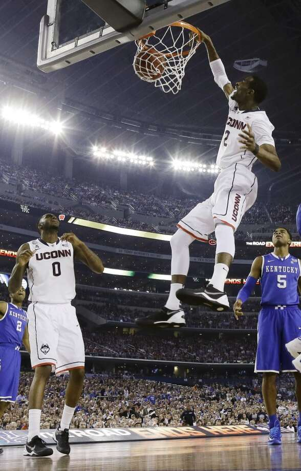 Connecticut forward DeAndre Daniels dunks against Kentucky during the first half of the NCAA Final Four tournament college basketball championship game Monday, April 7, 2014, in Arlington, Texas. (AP Photo/David J. Phillip) Photo: AP