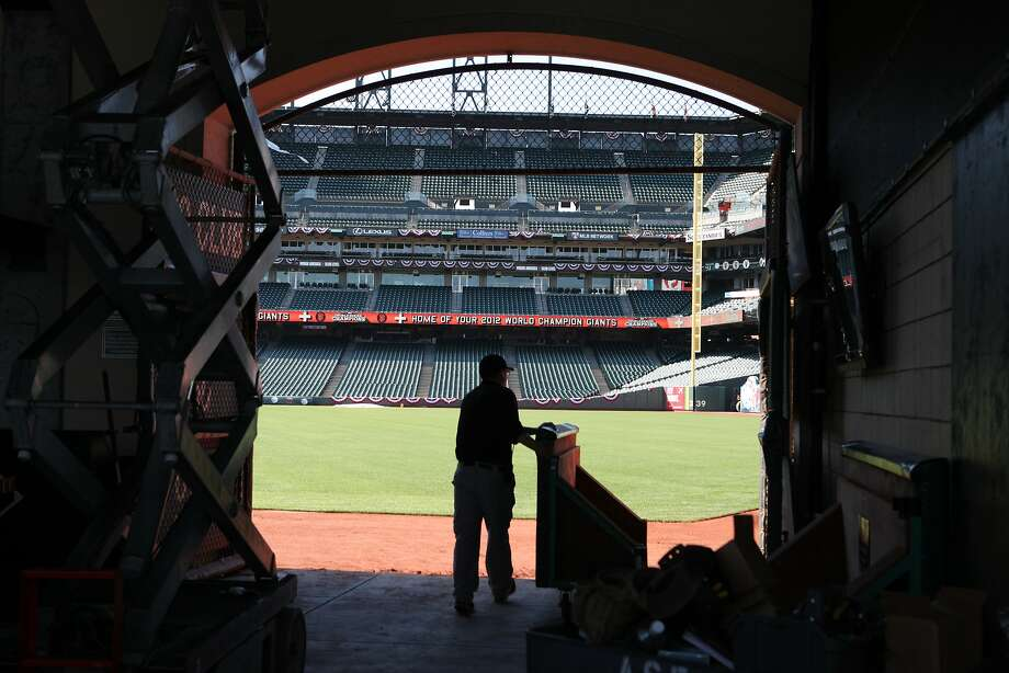 A worker at AT&T Park moves parts to set up a bar Monday in anticipation of the Giants' home opener against Arizona. Photo: Deborah Svoboda, The Chronicle