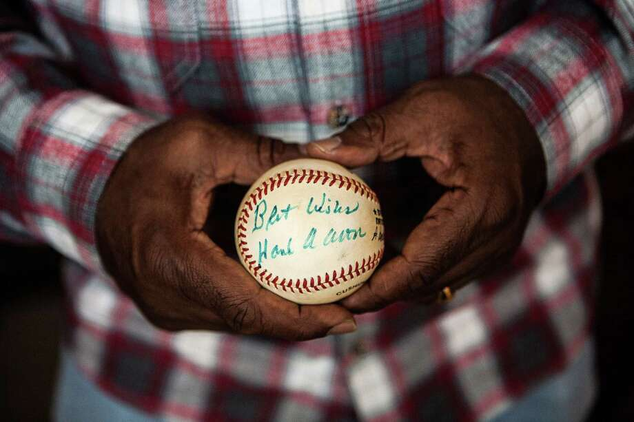 Garr holds a baseball autographed by Aaron, who took the younger player under his wing during their days in Atlanta. Photo: Michael Starghill, Jr., Photographer / © 2014 Michael Starghill, Jr.