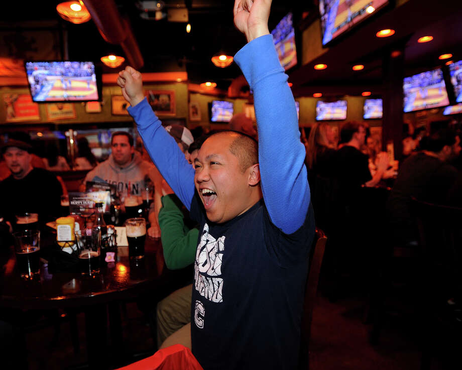 UCONN grad Eric Cheong of West Haven cheers a Huskies basket as he watches NCAA Men's Basketball Championship at The Tilted Kilt restaurant on Old Gate Lane in Milford, Conn. on Monday, April 6, 2014. Photo: Brian A. Pounds / Connecticut Post