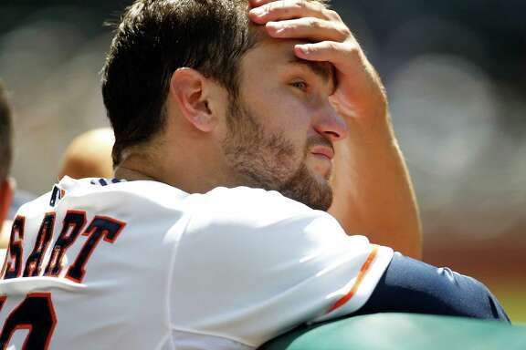 Jarred Cosart allowed five runs on three hits and four walks in six innings but was praised by his manager for battling.
