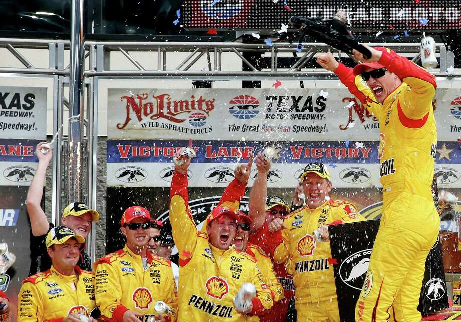 FORT WORTH, TX - APRIL 07:  Joey Logano, driver of the #22 Shell-Pennzoil/Hertz Ford, celebrates in Victory Lane after winning the NASCAR Sprint Cup Series Duck Commander 500 at Texas Motor Speedway on April 7, 2014 in Fort Worth, Texas.  (Photo by Chris Graythen/Getty Images for Texas Motor Speedway) ORG XMIT: 463750433 Photo: Chris Graythen / 2014 Getty Images