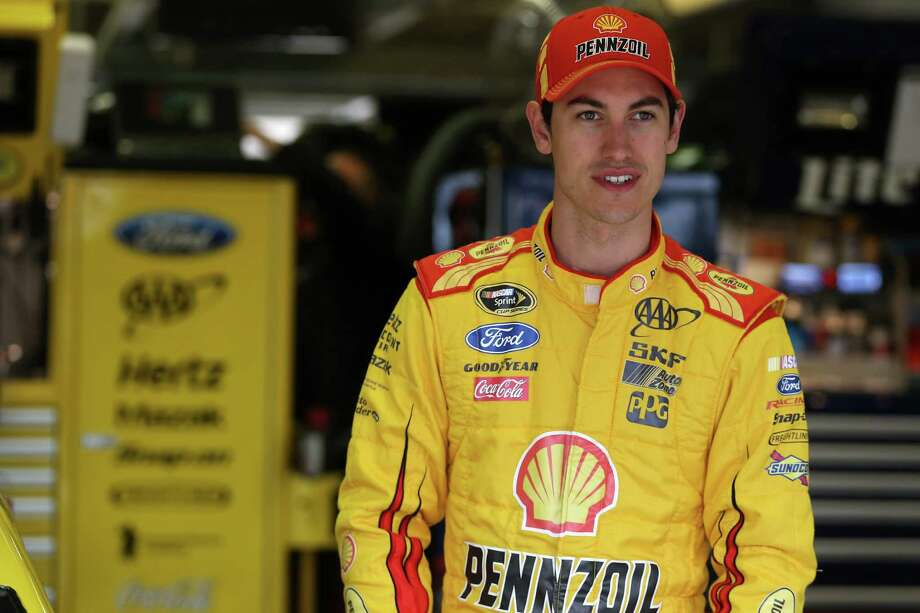 FORT WORTH, TX - APRIL 05:  Joey Logano, driver of the #22 Shell-Pennzoil/Hertz Ford, stands in the garage area during practice for the NASCAR Sprint Cup Series Duck Commander 500 at Texas Motor Speedway on April 5, 2014 in Fort Worth, Texas.  (Photo by Chris Graythen/Getty Images for Texas Motor Speedway) Photo: Chris Graythen, Staff / 2014 Getty Images